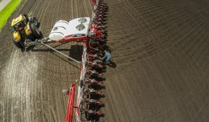 """A Farmer Optimizing his Massey Ferguson Planter For Current Soil Conditions"